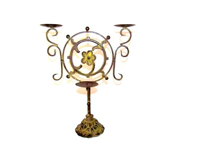 Vintage cast iron candelabra. Offered by Attic and Barn Treasures.