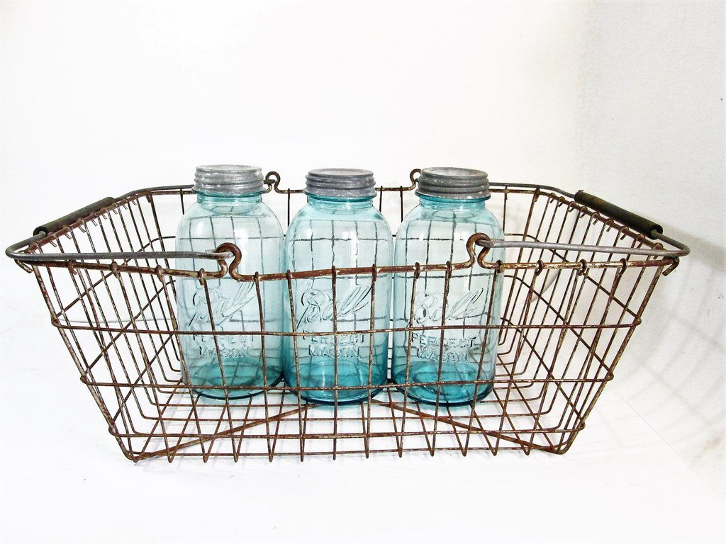 Vintage metal basket. Offered by Girl Pickers.